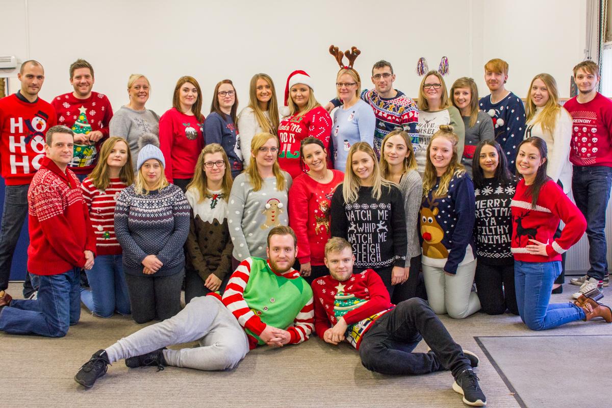 christmas-jumper-day-team-photo-2016.jpg